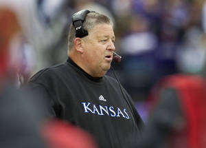 Photo -   Kansas coach Charlie Weis watches from the sideline during the first half of an NCAA college football game against the Kansas State in Manhattan, Kan., Saturday, Oct. 6, 2012. (AP Photo/Orlin Wagner)