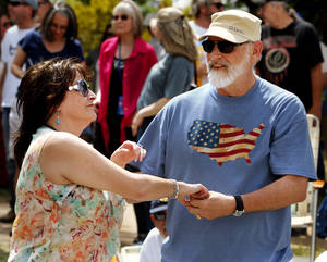 Photo -  Randy and Gaila Alexander dance near the Sailor Jerry Stage during the Norman Music Festival. PHOTO BY STEVE SISNEY, THE OKLAHOMAN  <strong>STEVE SISNEY -   </strong>