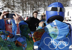 Photo - Austria's Matthias Mayer has his photo taken by volunteers near the finish area after completing men's downhill combined training at the Sochi 2014 Winter Olympics, Thursday, Feb. 13, 2014, in Krasnaya Polyana, Russia.  (AP Photo/Luca Bruno)