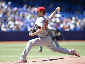 Photo - St. Louis Cardinals' pitcher Shelby Miller throws against the Toronto Blue Jays during the first inning of a baseball game in Toronto, Saturday, June 7, 2014. (AP Photo/The Canadian Press, Frank Gunn)