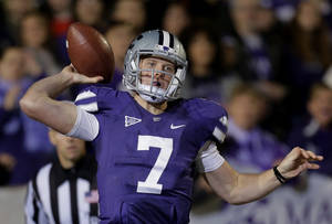 Photo - Kansas State quarterback Collin Klein throws during the first half of an NCAA college football game against Texas, Saturday, Dec. 1, 2012, in Manhattan, Kan. (AP Photo/Charlie Riedel)