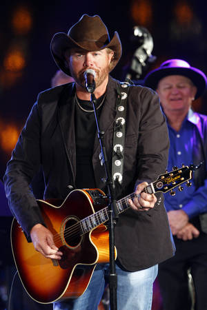 Photo - Toby Keith performs at the 60th Annual BMI Country Awards on Tuesday Oct. 30, 2012, in Nashville, Tenn. (Photo by Wade Payne/Invision/AP) ORG XMIT: TNWP807