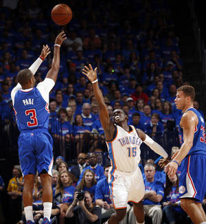 Photo - Los Angeles' Chris Paul (3) shoots against Oklahoma City's Reggie Jackson (15) next to Los Angeles' Blake Griffin (32) during Game 1 of the Western Conference semifinals in the NBA playoffs between the Oklahoma City Thunder and the Los Angeles Clippers at Chesapeake Energy Arena in Oklahoma City, Monday, May 5, 2014. Photo by Sarah Phipps, The Oklahoman