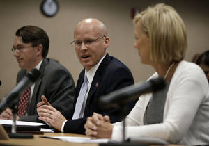 Photo -   Darin Gordon, center, director of TennCare, answers questions during budget hearings on Tuesday, Nov. 13, 2012, in Nashville, Tenn. At left is Casey Dungan, chief financial officer of TennCare, and at right is Dr. Wendy Long, chief medical officer. (AP Photo/Mark Humphrey)