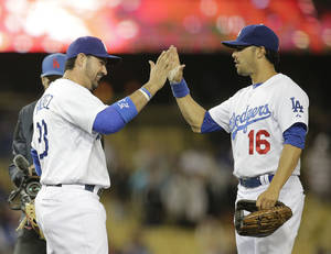 Photo - Los Angeles Dodgers' Adrian Gonzalez, left, and Andre Ethier celebrate their team's 5-2 win against the Chicago White Sox in a baseball game on Monday, June 2, 2014, in Los Angeles. (AP Photo/Jae C. Hong)
