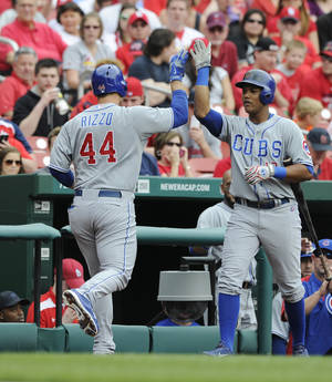 Photo - Chicago Cubs' Anthony Rizzo (44) is congratulated by teammate Starlin Castro, right, after Rizzo's two-run home run against the St. Louis Cardinals in the first inning of a baseball game, Sunday, April 13, 2014, in St. Louis. (AP Photo/Bill Boyce)