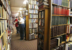 photo - Above: Despite a fire that could have destroyed more than 40,000 rare and used books, Aladdin Book Shoppe remains open for Christmas season business.  Photos by Jim Beckel, The Oklahoman