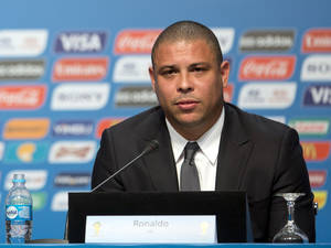 Photo - FILE - In this Feb. 21, 2014 file photo, Ronaldo, Brazil's former soccer player and a member of the local organizing committee for the 2014 World Cup, attends a news conference during the Team Workshop for the 2014 World Cup at the Costao do Santinho hotel in Florianopolis, Brazil. In the latest chapter of a spat between past Brazil football greats, Ronaldo is publicly criticizing former teammate Romario for making another attack on him, this time over an alleged broken promise to provide free tickets for people with disabilities during the World Cup. (AP Photo/Andre Penner, File)