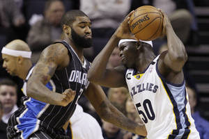 Photo - Memphis Grizzlies' Zach Randolph (50) is pressured by Orlando Magic's Kyle O'Quinn (2) during the first half of an NBA basketball game in Memphis, Tenn., Friday, Feb. 22, 2013. (AP Photo/Danny Johnston)