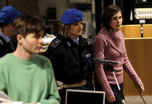 Photo - FILE - In this Saturday, Dec. 18, 2010 file photo U.S. student Amanda Knox, right, walks past Raffaele Sollecito, as she arrives after a break to attend a hearing in her appeals trial, at Perugia's courthouse, Italy. Italy's highest criminal court has overturned the acquittal of Amanda Knox and of her former Italian boyfriend, Raffaele Sollecito, in the slaying of her British roommate and ordered a new trial. The Court of Cassation ruled Tuesday, March 26, 2013 that an appeals court in Florence must re-hear the case against the American and her Italian-ex-boyfriend for the murder of 21-year-old Meredith Kercher   (AP Photo/Alessandra Tarantino)