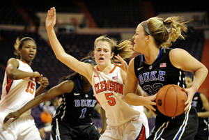 Photo - Duke's Tricia Liston, right,  drives through the baseline while being covered by Clemson's Kelly Gramlich (5) during the first half of an NCAA college basketball game, Thursday, Jan. 24, 2013, at Littlejohn Coliseum in Clemson, S.C. (AP Photo/Richard Shiro)