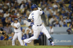 Photo - Los Angeles Dodgers' Juan Uribe hits his third solo home run of the game during the fifth inning a baseball game against the Arizona Diamondbacks on Monday, Sept. 9, 2013, in Los Angeles. (AP Photo/Jae C. Hong)