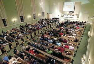 Photo - Same-sex couples and their supporters fill the sanctuary at All Souls Unitarian Church during a gay-marriage celebration in Tulsa. MATT BARNARD/Tulsa World