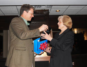 Photo - Gary James, president of Frankfurt Short Bruza, honors Gloria Stevens for her 50 years of service. PHOTO PROVIDED <strong></strong>
