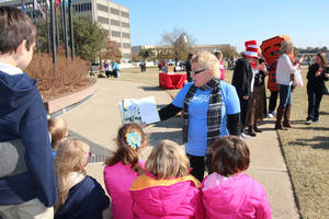 "Photo - Saundra Arnold, author of ""My Friend Isaac,"" reads to a group of children Friday at the state Capitol during the ReadOK event sponsored by the state Education Department. PHOTO PROVIDED <strong></strong>"