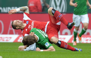 Photo - Bremen's Sebastian Proedl and Hamburg's Pierre-Michel Lasogga , top, challenge during the Bundesliga  soccer match between Werder Bremen and Hamburger SV  in Bremen, Germany, Saturday, March 1, 2014. (AP Photo/dpa,Carmen Jaspersen)