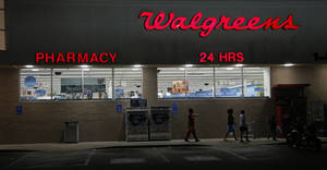 Photo - FILE - In this June 21, 2013, file photo, customers leave a Walgreens pharmacy in Jackson, Miss. Walgreen Co. reports quarterly financial results, Tuesday, March 25, 2014. (AP Photo/Rogelio V. Solis, File)