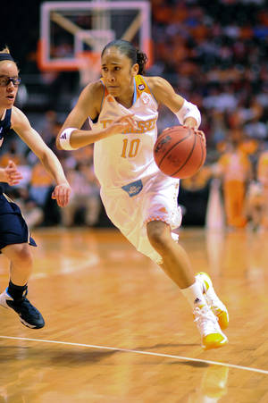 Photo - Tennessee's Meighan Simmons drives in the first half of an NCAA college basketball game against Chattanooga on Thursday, Nov. 14, 2013, in Knoxville, Tenn. (AP Photo/Patrick Murphy-Racey)
