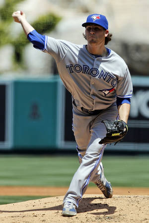 photo -   Toronto Blue Jays starting pitcher Drew Hutchison throws to the Los Angeles Angels during the second inning of a baseball game in Anaheim, Calif., Sunday, May 6, 2012. (AP Photo/Chris Carlson)