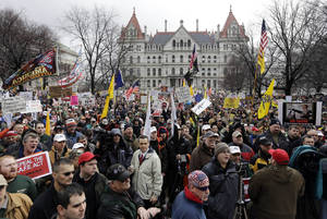 photo - Gun rights advocates demonstrate outside the Capitol on Thursday, Feb. 28, 2013, in Albany, N.Y. Thousands of opponents rallied against the recently legislated NY SAFE Act and other measures they say infringe on their constitutional right to bear arms. (AP Photo/Mike Groll)