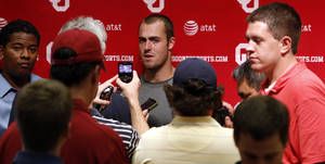 photo - Landry Jones (12) speaks to the press at a media availability for the University of Oklahoma Sooner (OU) football team following practice on Tuesday, Aug. 21, 2012 in Norman, Okla.  Photo by Steve Sisney, The Oklahoman
