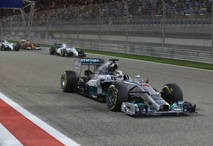 Photo - Mercedes driver Lewis Hamilton of Britain drives prior to the start of the Formula One Grand Prix at the Formula One Bahrain International Circuit in Sakhir, Bahrain, Sunday, April 6, 2014. (AP Photo/Patrick Baz, Pool)