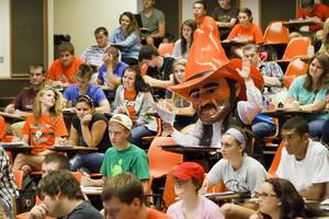 Photo - Pistol Pete raises his hand in favor of OSU's block tuition, recently approved by OSU-A&M Regents. Image from University Marketing/Oklahoma State University