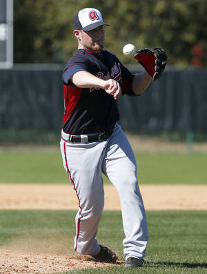 Photo - Atlanta Braves relief pitcher Craig Kimbrel makes a throw to home during a spring training baseball workout, Tuesday, Feb. 18, 2014, in Kissimmee, Fla. (AP Photo/Alex Brandon)