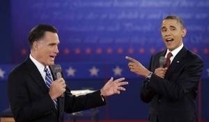 Photo - FILE - In this Oct. 16, 2012 file photo, President Barack Obama and Republican presidential candidate, former Massachusetts Gov. Mitt Romney exchange views during the second presidential debate at Hofstra University in Hempstead, N.Y.  (AP Photo/David Goldman, File)