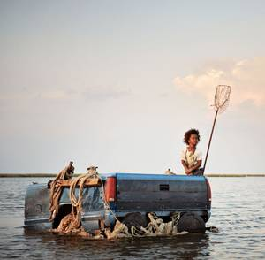"Photo - Quvenzhane Wallis stars in ""Beasts of the Southern Wild.""  Fox Searchlight photo"