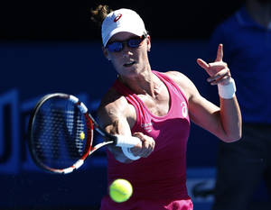 Photo - Samntha Stosur of Australia makes a forehand return to Klara Zakopalova of the Czech Republic during their first round match at the Australian Open tennis championship in Melbourne, Australia, Monday, Jan. 13, 2014.(AP Photo/Eugene Hoshiko)