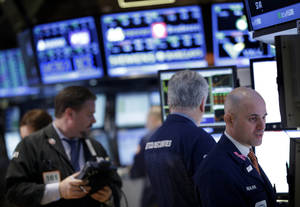 photo - Traders work on the floor at the New York Stock Exchange in New York, Wednesday, Feb. 27, 2013. Stocks surged for a second day, putting the Dow on track for its highest close of the year.  (AP Photo/Seth Wenig)
