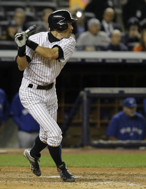 Photo -   New York Yankees' Ichiro Suzuki watches his eighth-inning RBI-single against the Toronto Blue Jays in Game 2 of a baseball doubleheader at Yankee Stadium in New York, Wednesday, Sept. 19, 2012. Suzuki had the winning hit and four stolen bases in the Yankees' victory. (AP Photo/Kathy Willens)