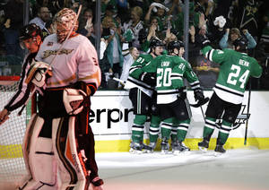Photo - Anaheim Ducks' Frederik Andersen (31) stands by the net as Dallas Stars' Cody Eakin (20) celebrates his goal with Antoine Roussel (21 and Jordie Benn (24) in the third period of Game 4 of a first-round NHL hockey Stanley Cup playoff series, Wednesday, April 23, 2014, in Dallas. The Stars won 4-2.  (AP Photo/Tony Gutierrez)