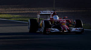 Photo - Fernando Alonso of Spain and Ferrari drives the new F14T car during the 2014 Formula One Testing at the Circuito de Jerez on Thursday, Jan. 30, 2014, in Jerez de la Frontera, Spain. (AP Photo/Miguel Angel Morenatti)