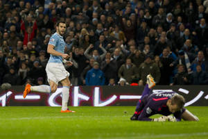 Photo - Manchester City's Alvaro Negredo, left, turns to celebrate after scoring past Liverpool's goalkeeper Simon Mignolet during their English Premier League soccer match at the Etihad Stadium, Manchester, England, Thursday Dec. 26, 2013. (AP Photo/Jon Super)