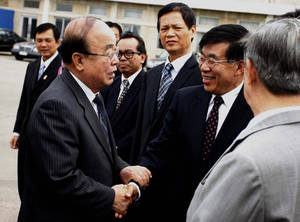 Photo - North Korean Foreign Minister Pak Ui Chun, left, shakes hands with Chinese Ambassador to North Korea Liu Hongcai at Pyongyang airport, North Korea, Saturday, June 29, 2013 before leaving for Brunei to attend the ASEAN foreign ministers meeting. The regional security summit in Brunei is the sort of venue where North Korea has often managed to open up sideline discussions with Seoul and Washington. This time, while there will be plenty of talk about Pyongyang, there is little chance of substantive talk with it. (AP Photo/Kim Kwang Hyon)