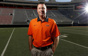 Photo - OKLAHOMA STATE UNIVERSITY / COLLEGE FOOTBALL: OSU head football coach Mike Gundy during media day for the OSU football team at Gallagher-Iba Arena in Stillwater, Okla., Saturday, Aug. 4, 2012. Photo by Sarah Phipps, The Oklahoman