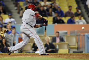 photo -   Los Angeles Angels' Erick Aybar hits a solo home run during the ninth inning of their interleague baseball game against the Los Angeles Dodgers, Wednesday, June 13, 2012, in Los Angeles. (AP Photo/Mark J. Terrill)