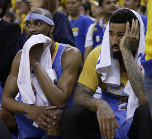 Photo - Denver Nuggets' Corey Brewer, left, and Wilson Chandler watch from the bench during the second half of Game 4 in a first-round NBA basketball playoff series against the Golden State Warriors on Sunday, April 28, 2013, in Oakland, Calif. (AP Photo/Ben Margot)