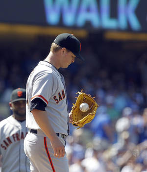 Photo - San Francisco Giants starting pitcher Matt Cain looks away after walking Los Angeles Dodgers' Hanley Ramirez in the sixth inning of a baseball game on Saturday, May 10, 2014, in Los Angeles. Cain was removed from the game after walking Ramirez. (AP Photo/Alex Gallardo)