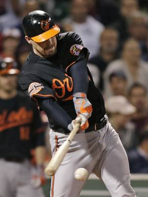 Photo -   Baltimore Orioles' Matt Wieters connects on a two-run single in the fourth inning of a baseball game against the Boston Red Sox at Fenway Park in Boston, Friday, Sept. 21, 2012. (AP Photo/Charles Krupa)