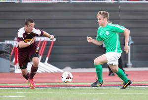Photo -  Kyle Greig, right, dribbles the ball during the OKC Energy FC's preseason game against the Midwestern State University Mustangs at Yukon on March 29. Photo by Steven Christy/Oklahoma City Energy FC  <strong>Steven Christy -  Steven Christy </strong>