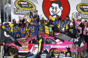 Photo -   Matt Kenseth celebrates in Victory Lane after winning the NASCAR Sprint Cup Series auto race at Talladega Superspeedway in Talladega, Ala., Sunday, Oct. 7, 2012. (AP Photo/Butch Dill)