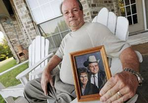 photo - Terry Haynes holds a photo of his parents, Doris Haynes and Boyd Haynes, as he sits in one of the chairs his father made, at his home in Oklahoma City, Thursday, July 14, 2011. Cherokee Ballard, spokeswoman for the Oklahoma medical examiner, said the deaths of Boyd Haynes, 87, and Doris Haynes, 86, have been ruled homicides. The couple was couple found dead after their house was firebombed Wednesday. Photo by Nate Billings, The Oklahoman ORG XMIT: KOD