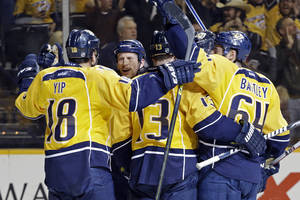 photo - Nashville Predators center Nick Spaling (13) celebrates with Brandon Yip (18), Rich Clune, second from left, and Victor Bartley (64) after Spaling scored against the Calgary Flames in the second period of an NHL hockey game, Thursday, March 21, 2013, in Nashville, Tenn. (AP Photo/Mark Humphrey)