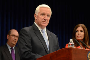 Photo - FILE - In a Friday, June 27, 2014 file photo, Pennsylvania Gov. Tom Corbett speaks during at a Capitol news conference to announce details of an agreement to allow some Highmark subscribers to continue using UPMC doctors and facilities at in-network rates after the Jan. 1 end of a contract between the two western Pennsylvania health care giants in Harrisburg, Pa. Corbett says he will soon be putting up a new round of television advertisements, with about four months to go before voters will decide whether he deserves a second term.  (AP Photo/Marc Levy, File)