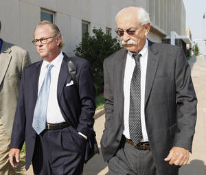 Photo - Defense attorney John Coyle and gambler Richard Allen Hancock, right, leave the Oklahoma City federal courthouse Wednesday after his sentencing for illegal gambling. Photo by Paul B. Southerland, The Oklahoman