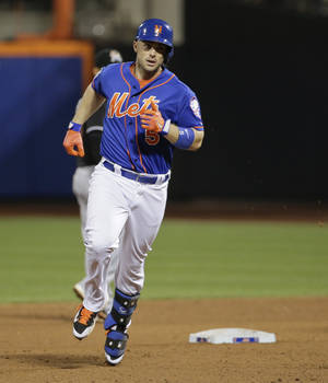 Photo - New York Mets' David Wright rounds the bases after hitting a two-run home run against the Miami Marlins in the fifth inning of a baseball game, Friday, July 11, 2014, in New York. Wright was 4 for 4 in the Mets' 7-1 win. (AP Photo/Julie Jacobson)