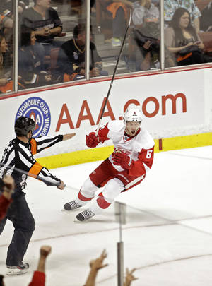 Photo - Detroit Red Wings left wing Justin Abdelkader celebrates his short handed goal during the first period in Game 7 of their first-round NHL hockey Stanley Cup playoff series against the Anaheim Ducks in Anaheim, Calif., Sunday, May 12, 2013. (AP Photo/Chris Carlson)